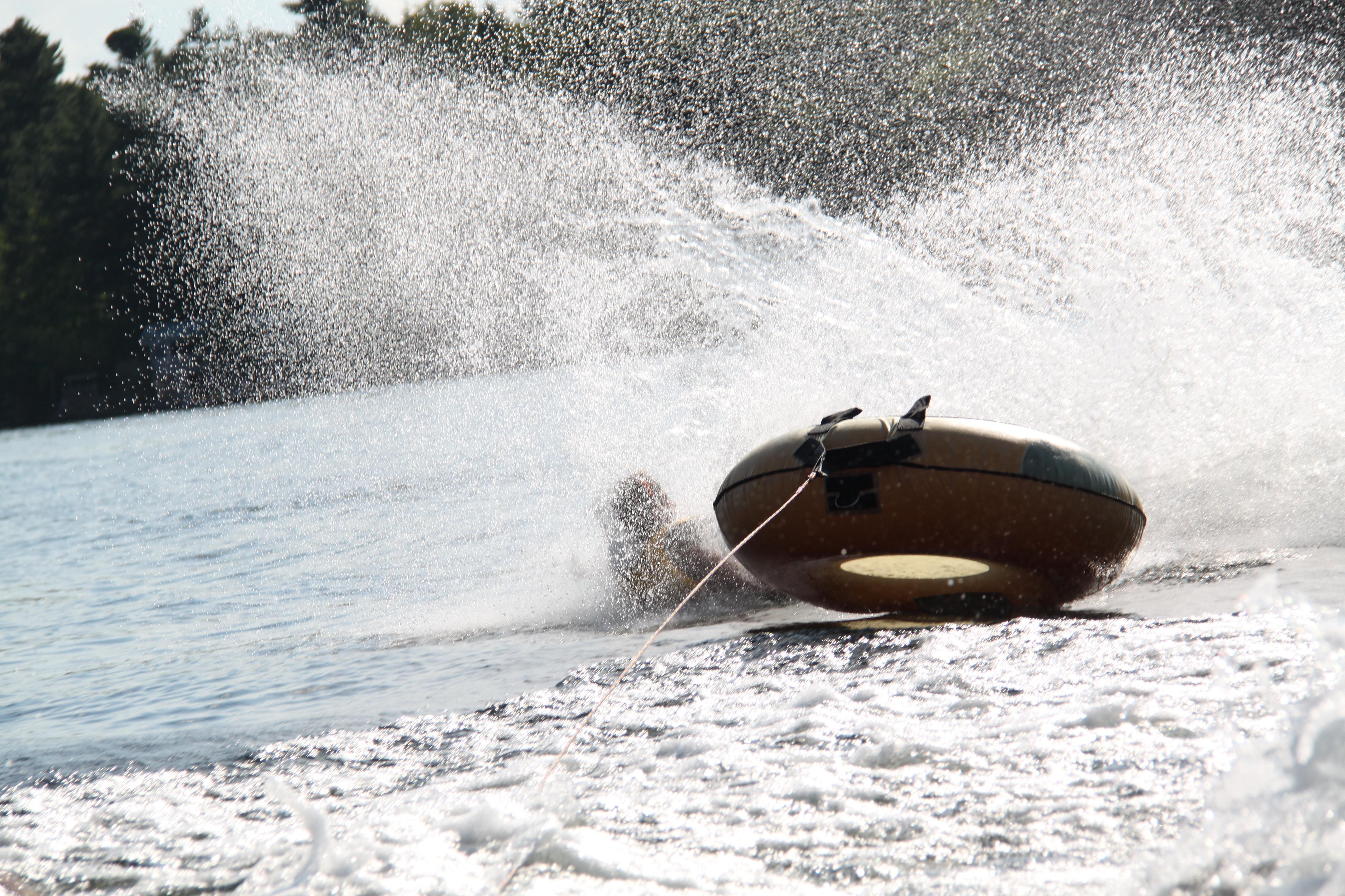 Tuber getting dunked in Charleston Lake, Ontario.